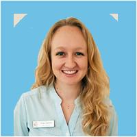 smiling Erika Salmon waring an Andrea Cooper Speech Pathology shirt