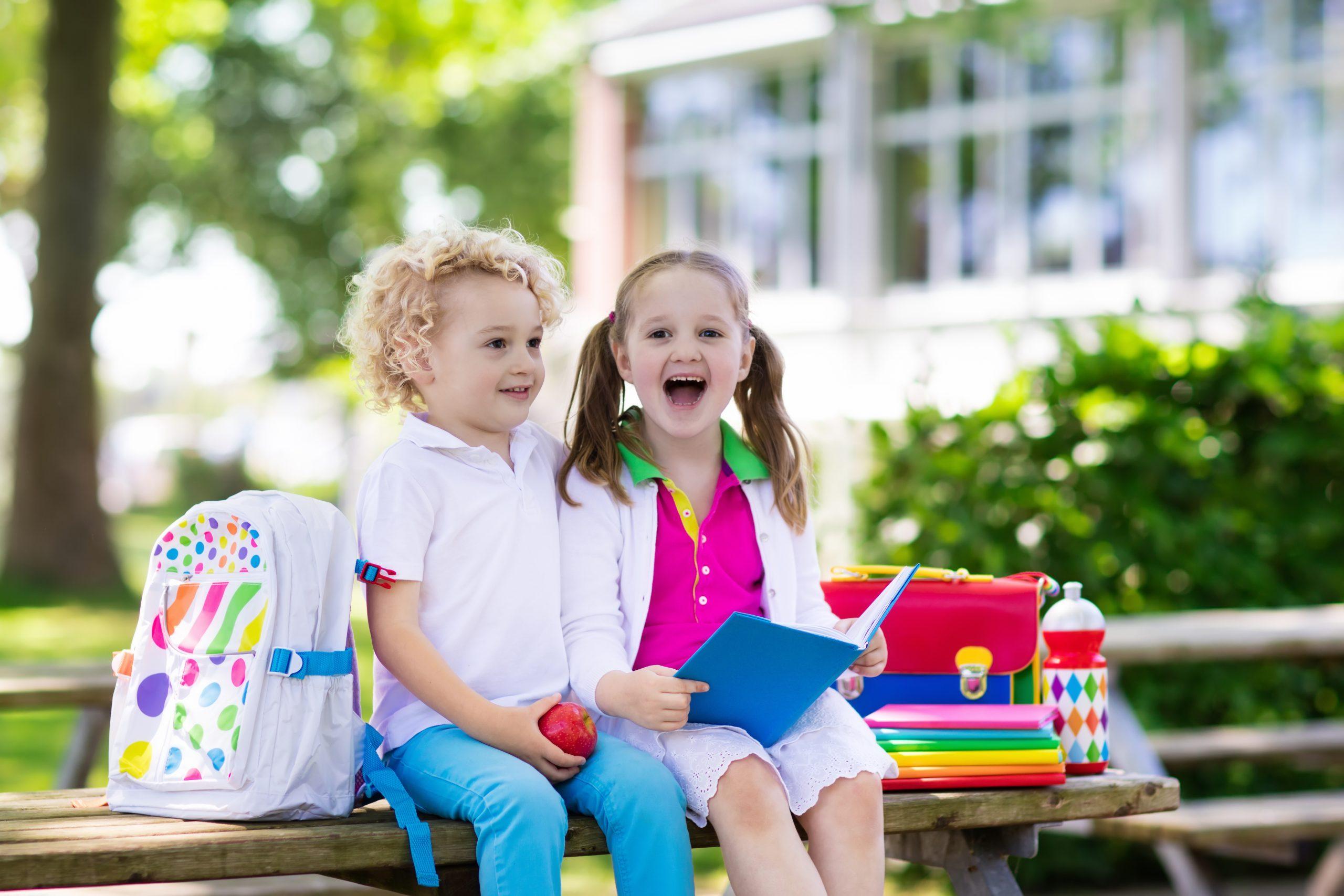 children sitting on school bench