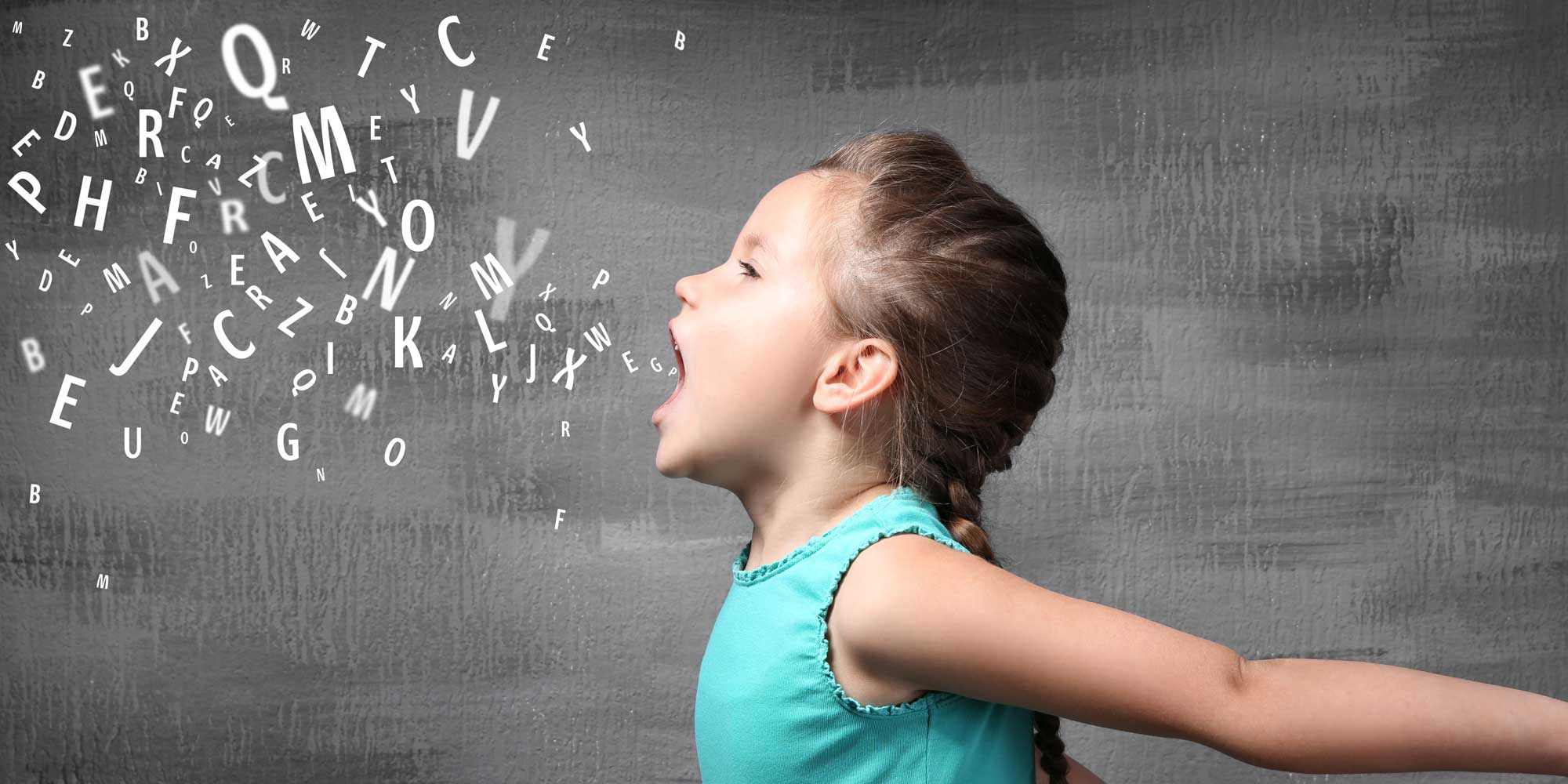 young girl exhaling cloud of letters