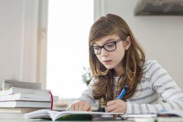 teenaged girl doing homework